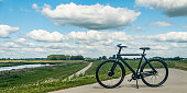 VanMoof S3 Ebike in a rural landscape during a beautiful summer day in The Netherlands.