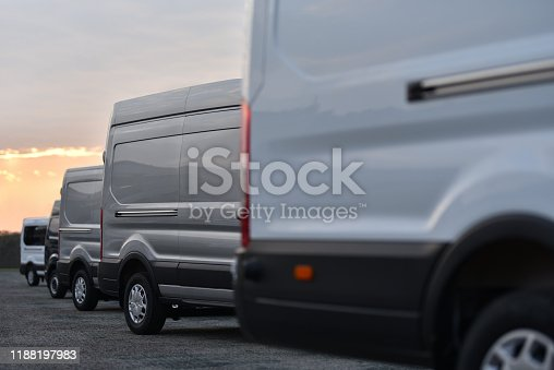 vans of delivery service parked in row