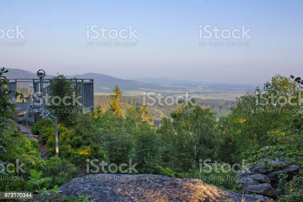 Photo of Vantage point Mandelstein with trees and blue sky, Austria