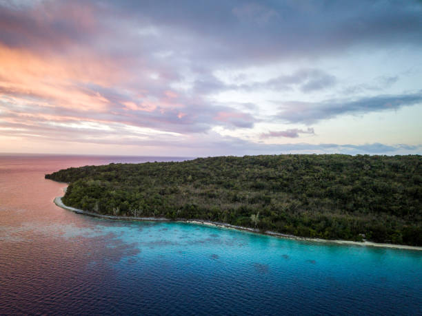 Vanuatu Efate Island Sunset Aerial View Port Villa Beautiful aerial drone point of view towards the blue coral island lagoon of the Moso Islet close to Efate Main Island, Vanatu, Pacific Ring of Fire, South Pacific. vanuatu stock pictures, royalty-free photos & images