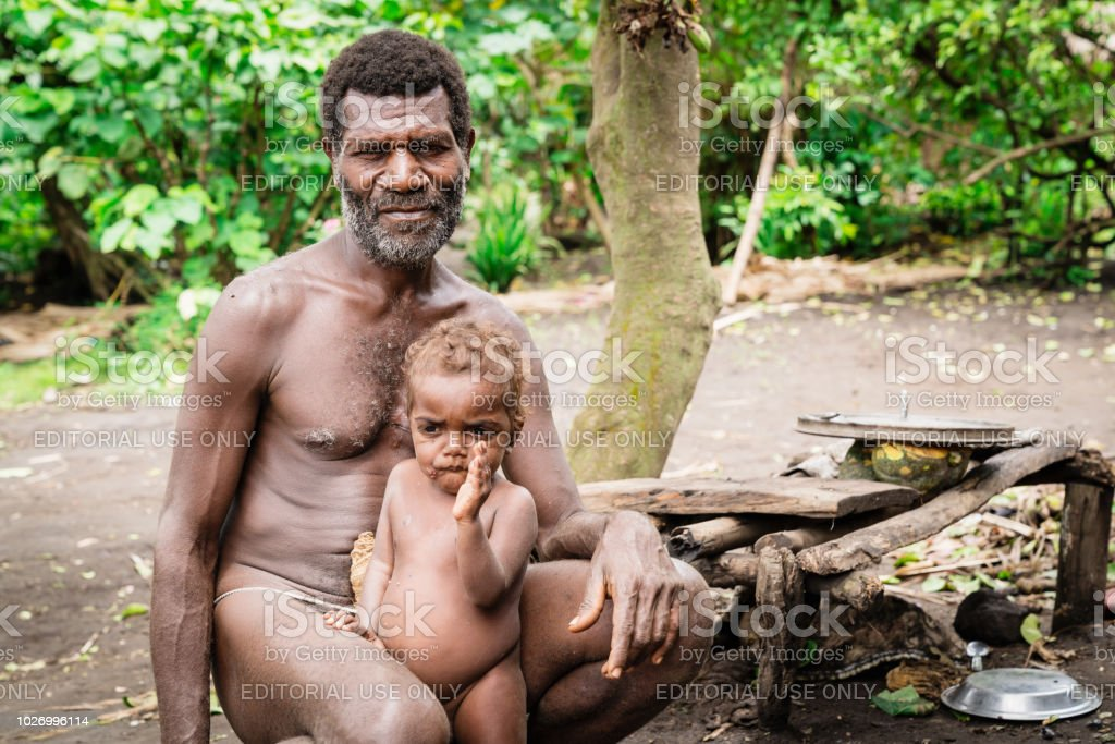 Vanuatu Tanna Island Tribe Father and Son Kastom Village stock photo