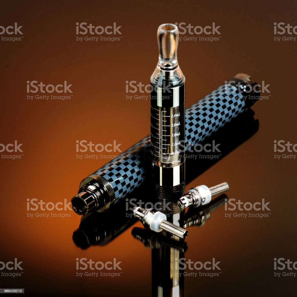 Vape (electronic cigarette) in the sorted look against a dark background. stock photo