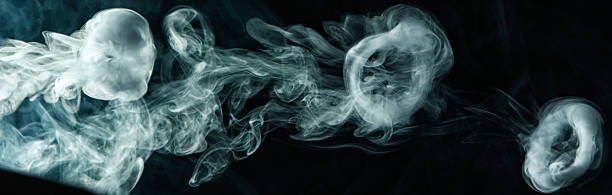 Vape trick smoke ring on dark background stock photo