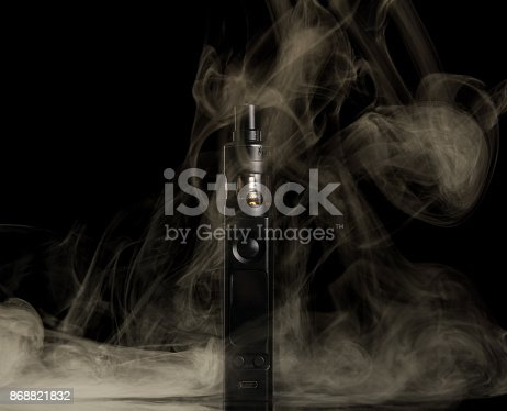177005367 istock photo Vaping. Couples from an electronic cigarette isolated on black 868821832
