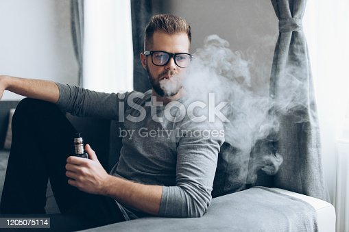 istock Vaping e-liquid from an electronic cigarette 1205075114