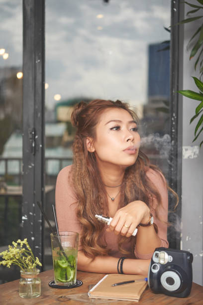 Vaping in cafe stock photo