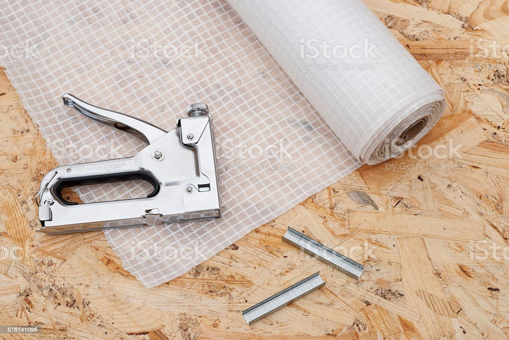 vapor barrier and mounting a stapler stock photo
