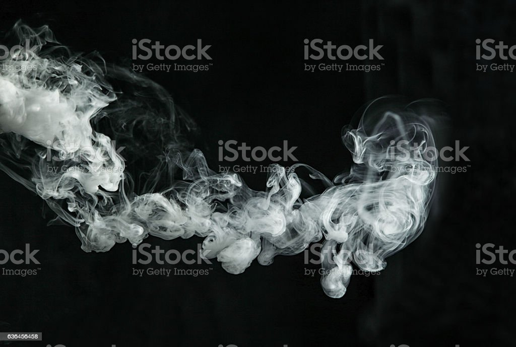Vapor like smoke on a dark background stock photo