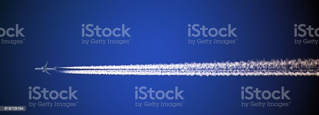 vapor trail in blue sky stock photo