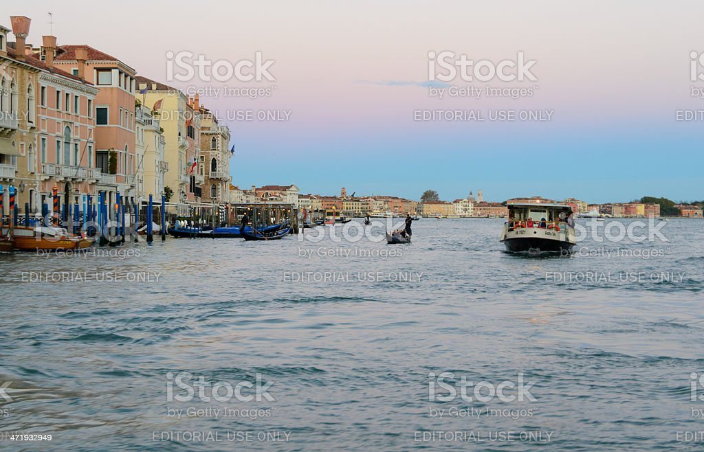 Vaporetto and Gondola on the Grand Canal in Venice royalty-free stock photo