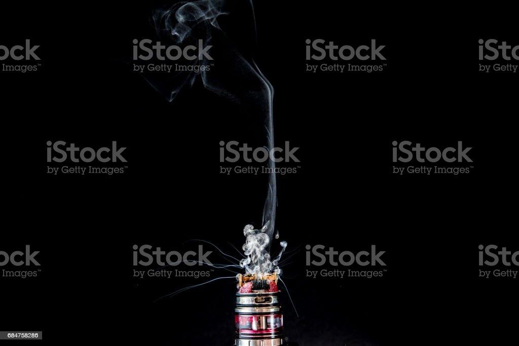 Vaporizer tank with cloud of vapor stock photo