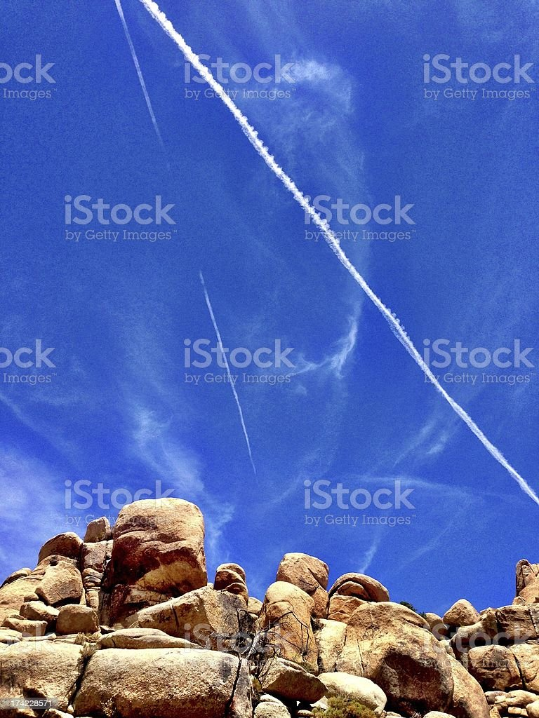 Vapour Trails in the sky above Joshua Tree National Park royalty-free stock photo