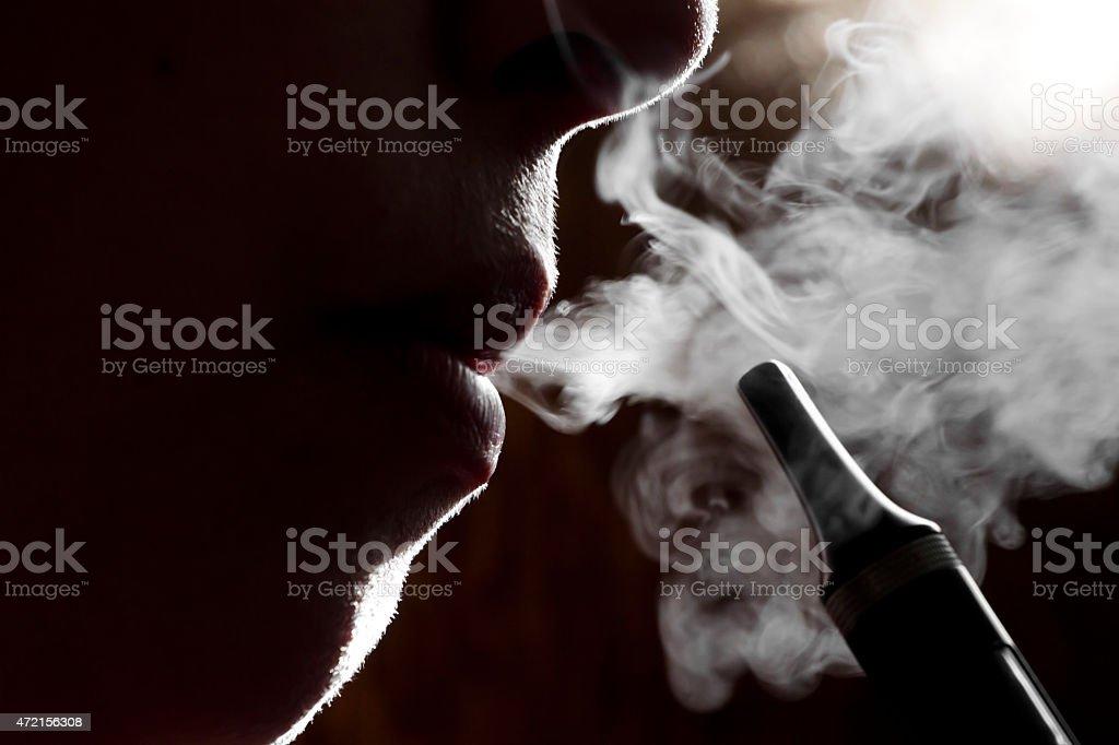 vapouring e cigarette close up stock photo