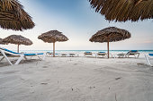 beach chairs and umbrellas at Varadero beach, Cuba.