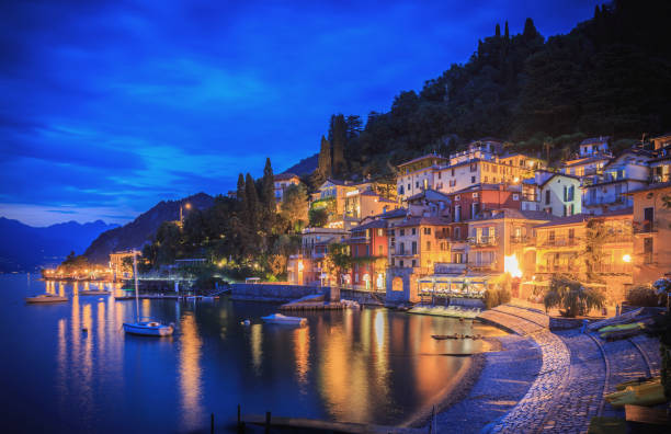 Varenna on the shore of Lake Como, Italy, showing houses, bars and restaurants in the evening. stock photo