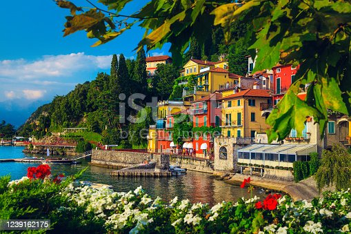 Flowery garden on the lake shore and beautiful view with colorful buildings, lake Como, Varenna, Italy, Europe