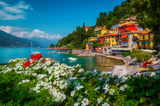 Varenna resort view with anchored boats in harbor, lake Como stock photo