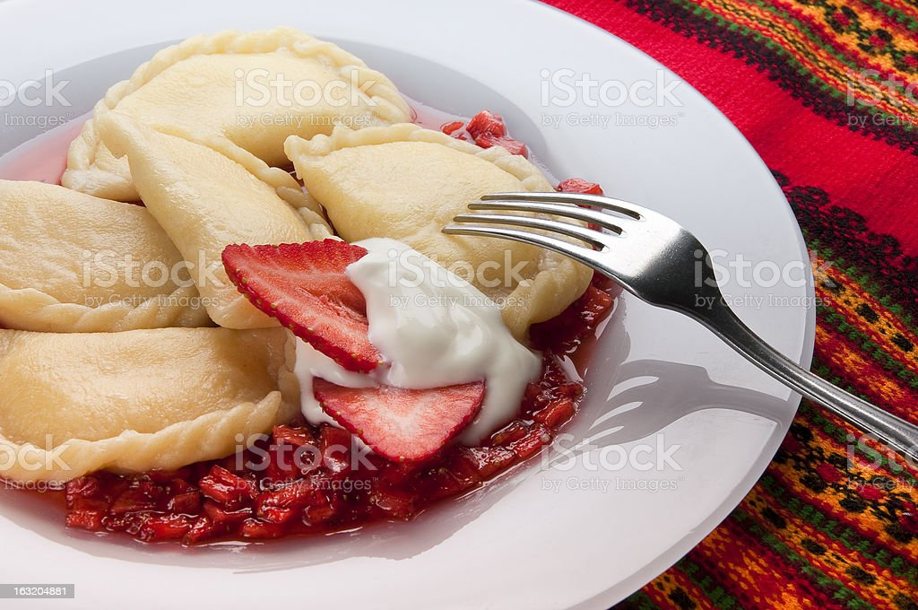 Varenyky with strawberry sauce royalty-free stock photo