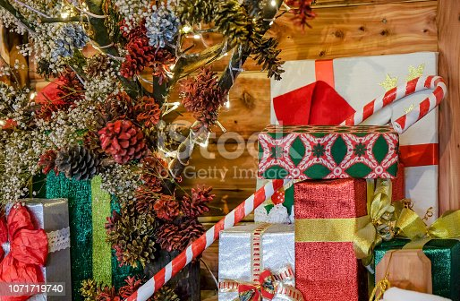 Close up large group of christmas presents with a decorative