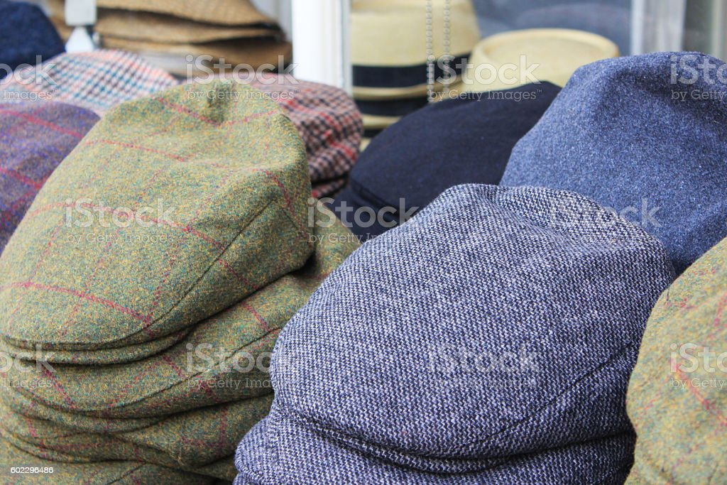 Variation men's newsboy cap stack in clothing store stock photo