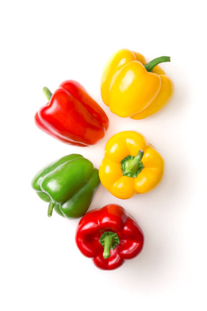 variation of different color bell peppers on a white background. colorful paprikas viewed from above isolated on white. top view - papryka słodka zdjęcia i obrazy z banku zdjęć