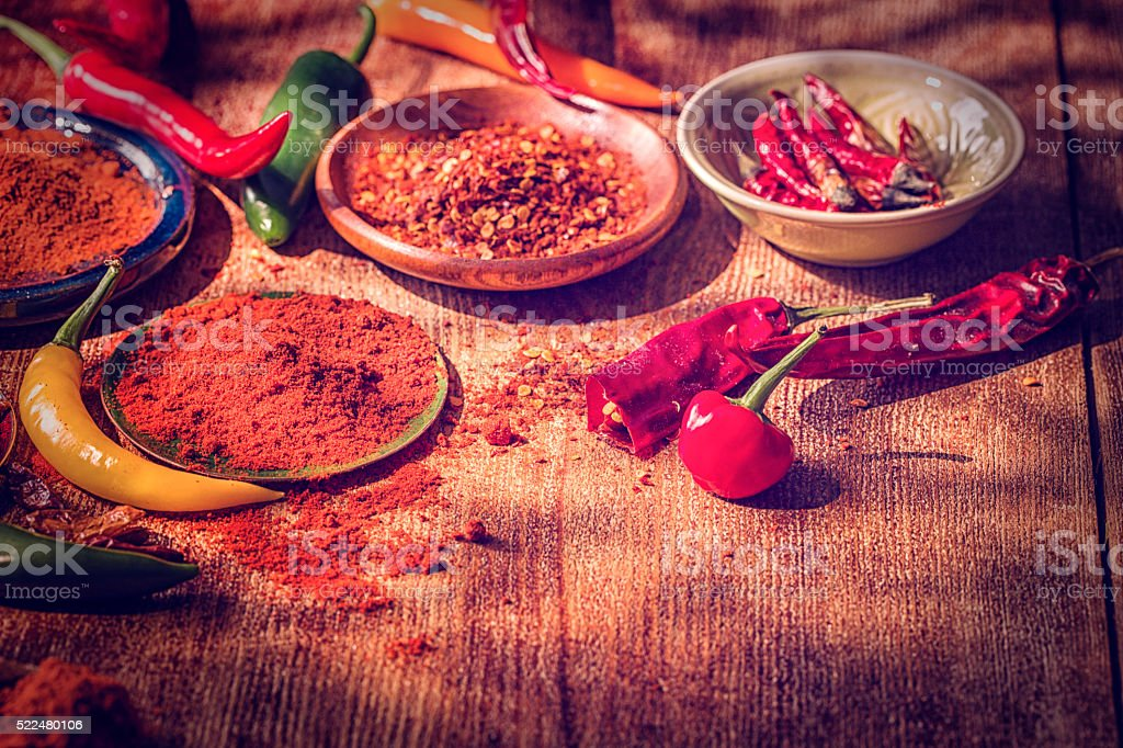 Variation of Fresh and Dried Chili Peppers stock photo