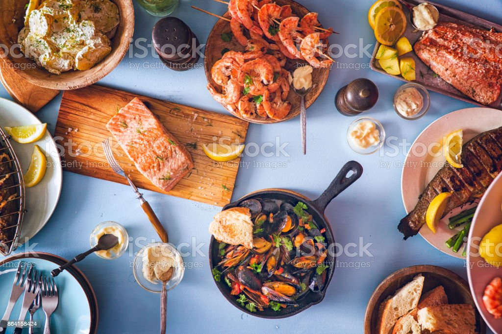 Variation of Grilled Prawns and Salmon with Fresh Lemon stock photo