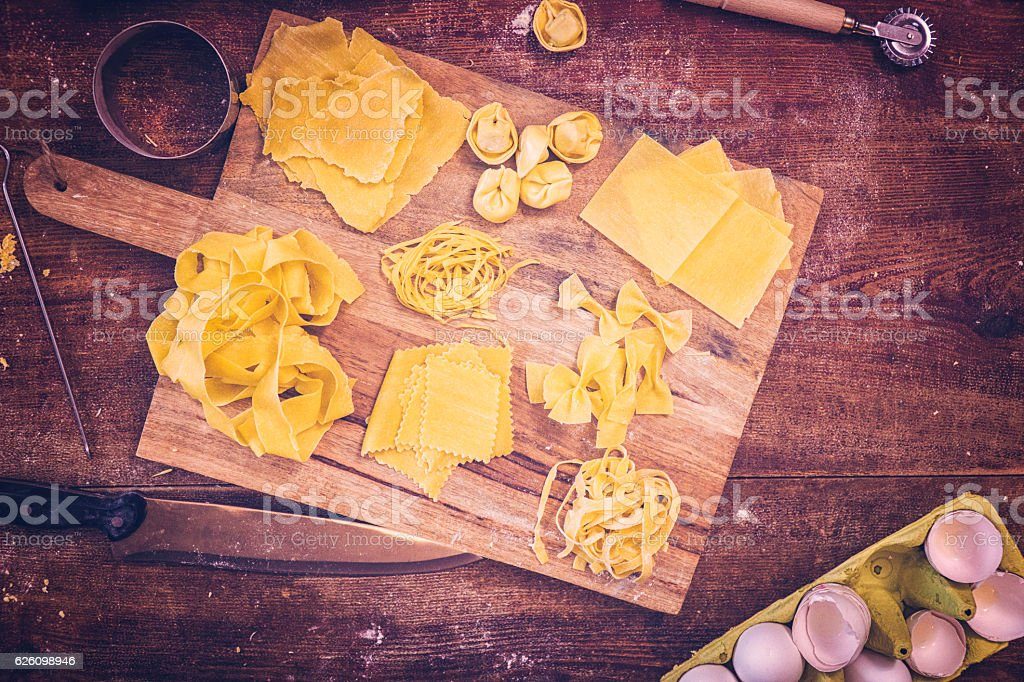 Variation of Raw Homemade Pasta on Wooden Background stock photo