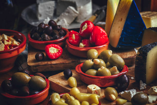 Variation of Spanish Appetizer Good Quality Cheese, Olives and Filled Bell Pepper stock photo