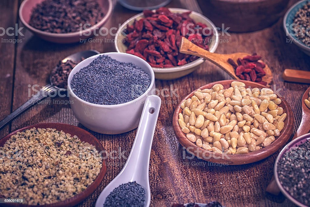 Variation of Superfood Chia, Quinoa, Poppy Seed and Nuts stock photo