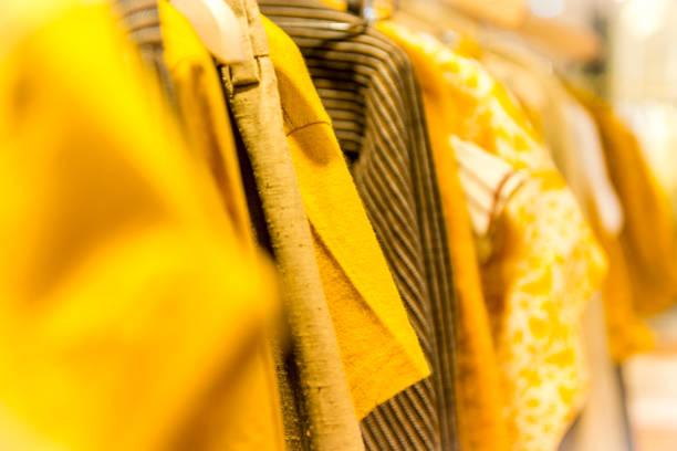 variation of yellow shirts stock photo