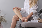 istock Varicose vein laser surgery recovery and prevention, Compression Stockings Thigh 1206696871