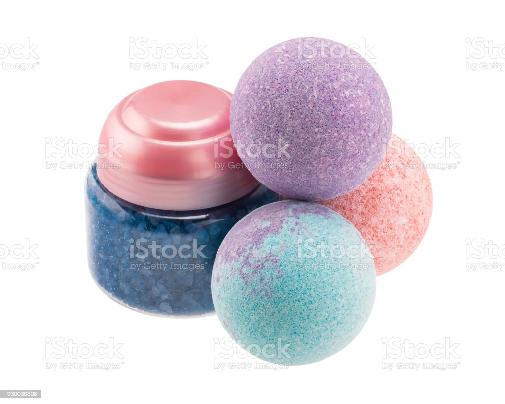 Variegated bath bombs and bottle with blue sea salt stock photo