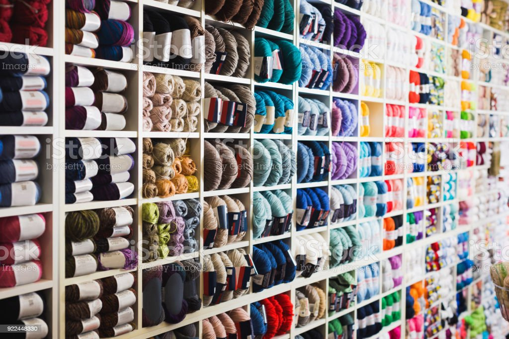 Variegated yarns for knitting on shop shelf stock photo