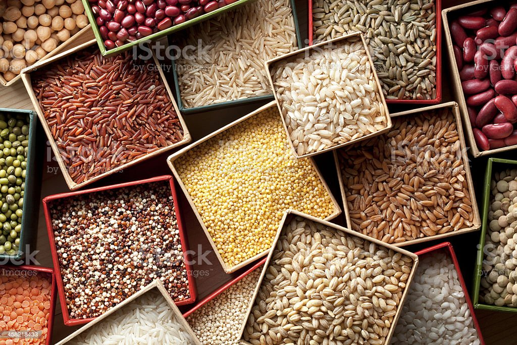 Varieties of grains seeds and beans stock photo
