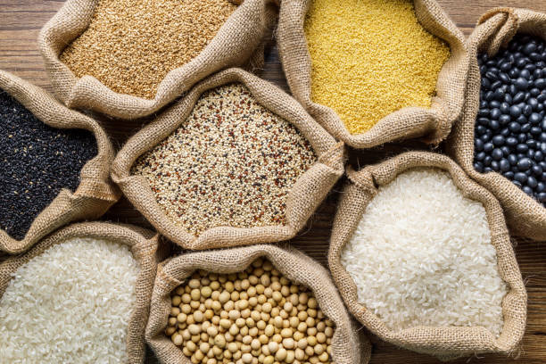varieties of grains seeds and raw quino - quinoa stock photos and pictures