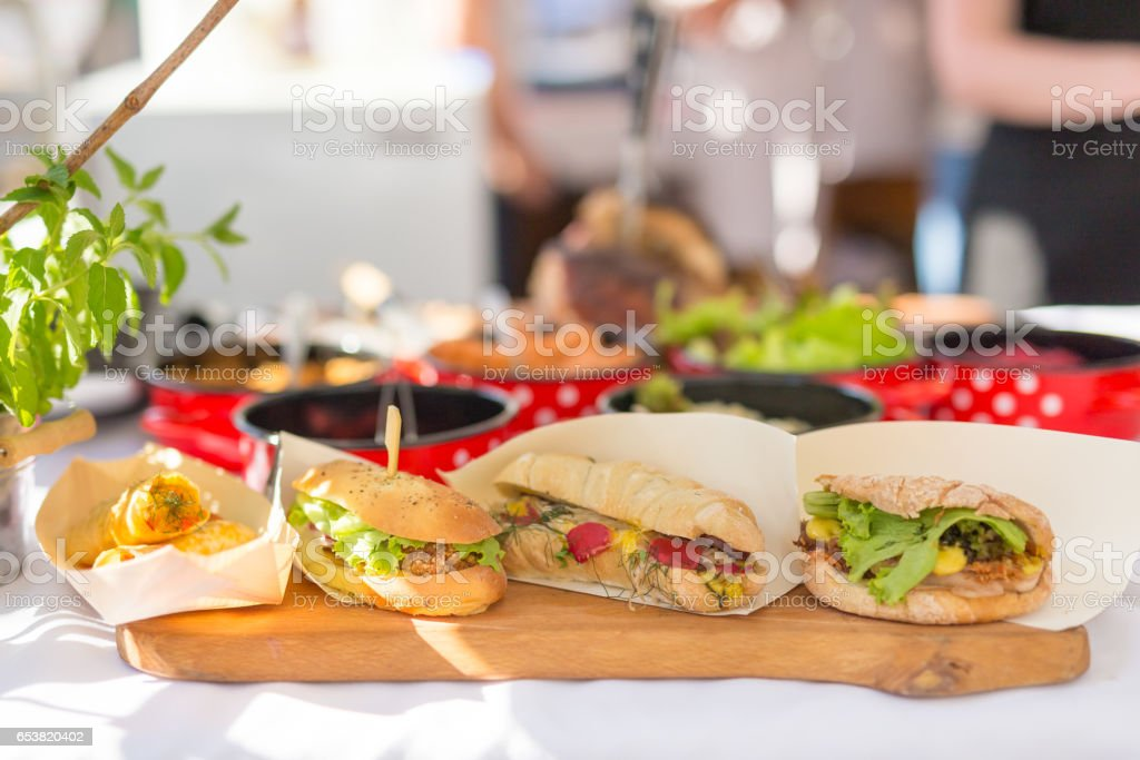 Varieties of home made sandwiches beeing sold on street stall. stock photo