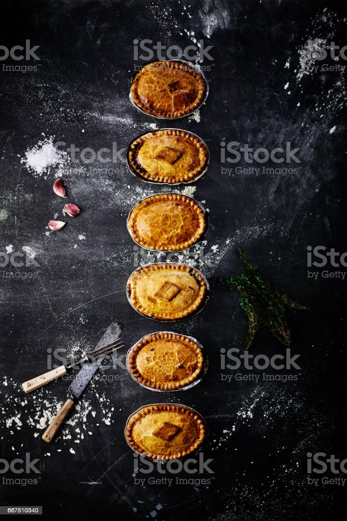 Varieties of meat and vegetarian pies on table stock photo