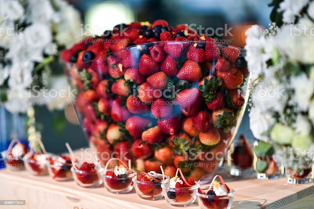 Variety Berries in glass bowl. - foto de acervo