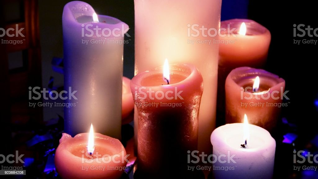 Variety candles flame in romantic mood at night stock photo