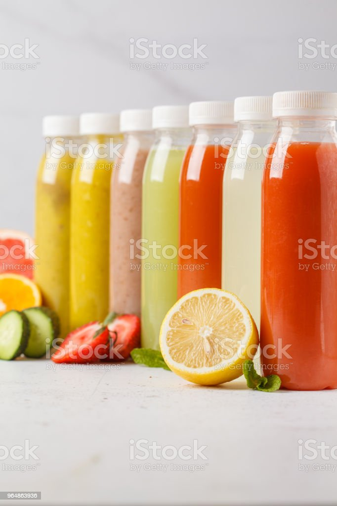 Variety colorful smoothie or juice bottles from berries, fruits and vegetables. Detox program, healthy lifestyle concept. royalty-free stock photo