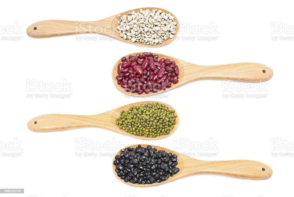 Variety grain in wooden spoon. stock photo