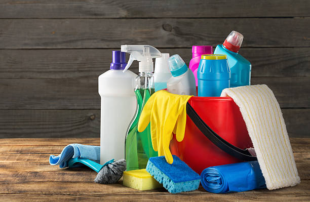 Variety house cleaning product on wood table stock photo