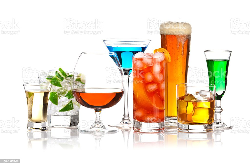 Variety of alcholic drinks on reflective white background stock photo