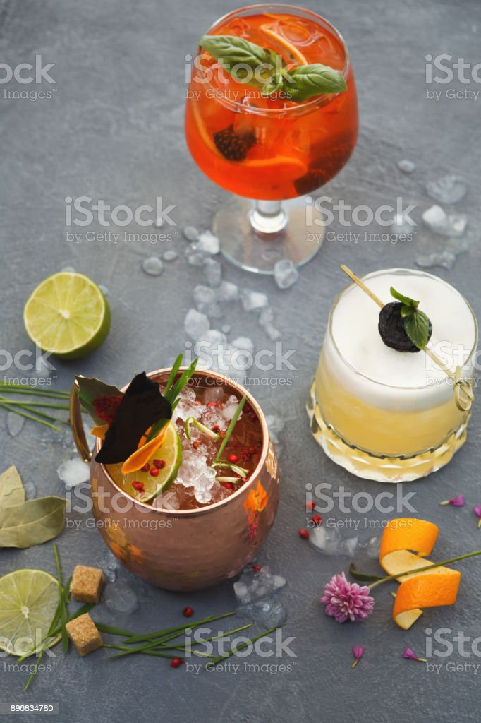 Variety of alcohol cocktails on gray table stock photo
