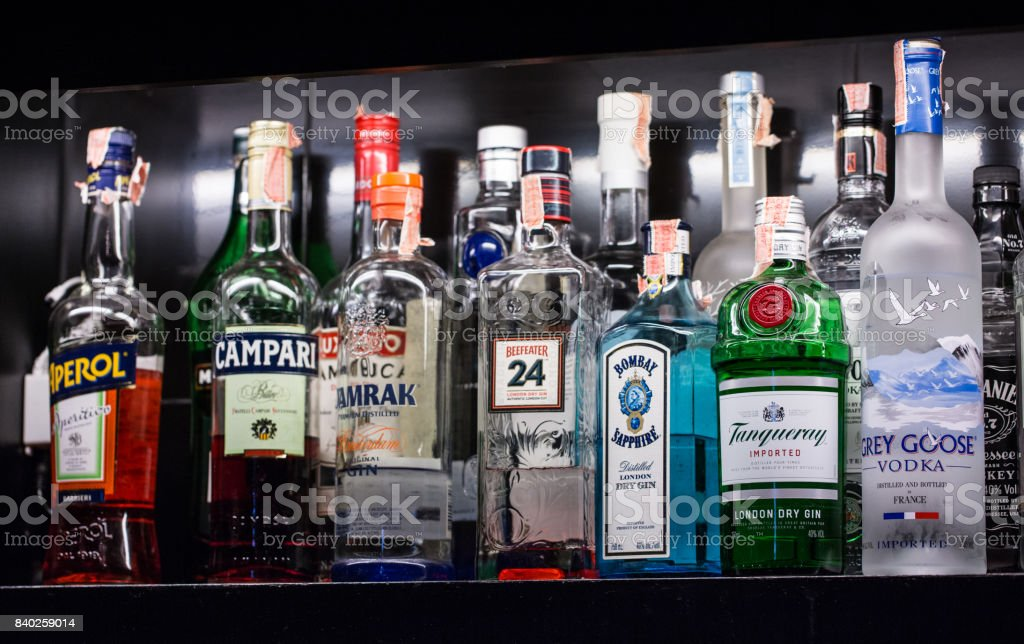 A variety of alcoholic beverages, Bernd, are placed on shelves in the bar for cocktails. stock photo