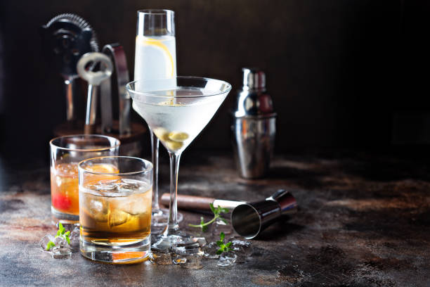 Variety of alcoholic cocktails Variety of alcoholic cocktails on dark background bartender stock pictures, royalty-free photos & images