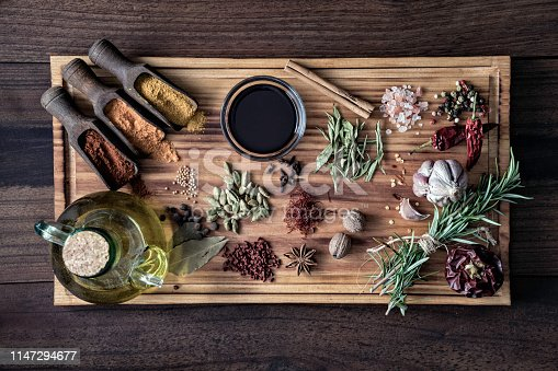 istock Variety of allspice ingredients and condiments for food seasoning on cutting board in old fashioned kitchen 1147294677