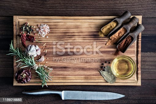 istock Variety of allspice ingredients and condiments for food seasoning on cutting board in old fashioned kitchen 1159016683