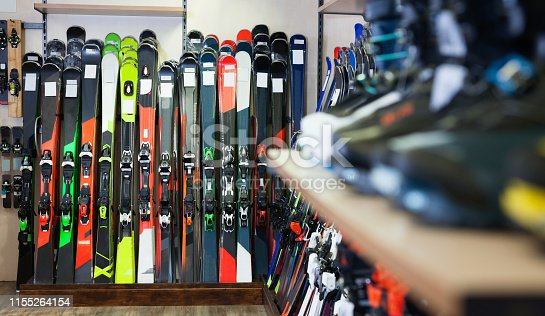 Variety of new colorful  alpine skis for sale in modern sports equipment store